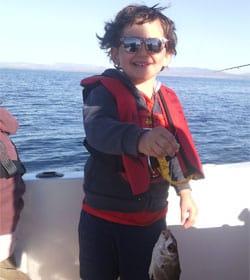 Initiation à la pêche en mer en bateau pour enfants et famille
